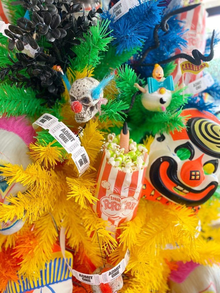 Creepy clown and carnival themed rainbow Halloween tree.