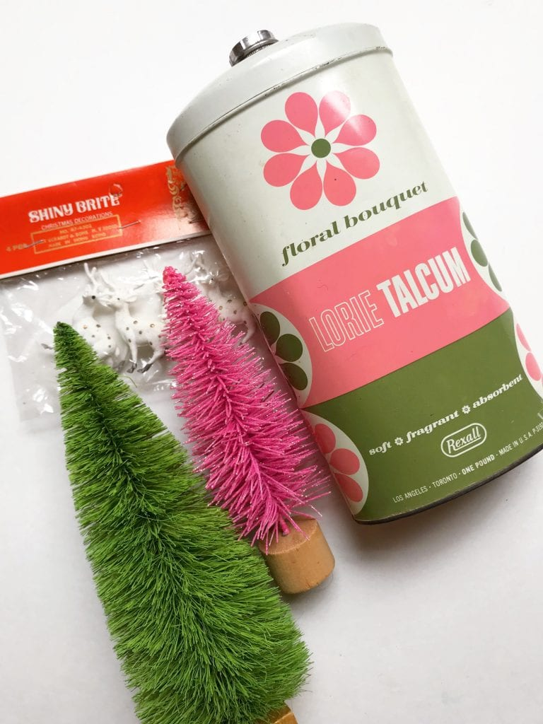 Supplies for making a DIY Kitschmas diorama in a vintage talcum powder tin.