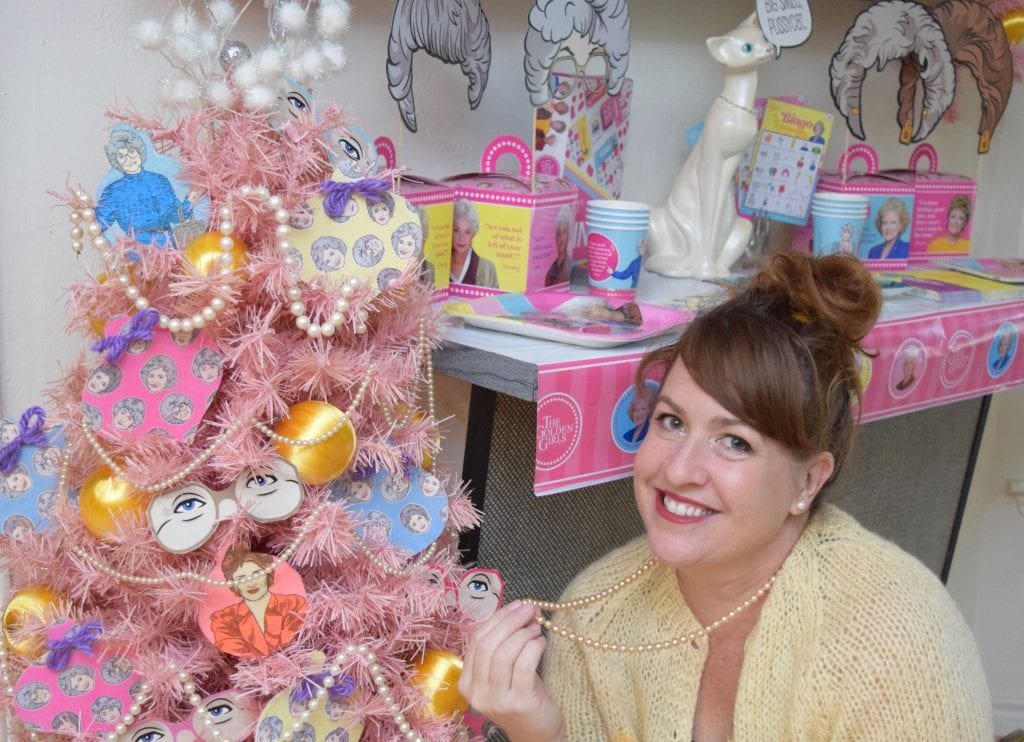 Jennifer Perkins decorates a pink Christmas tree with a Golden Girls theme and DIY decoupage ornaments.