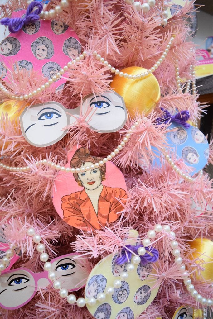 Pink Christmas tree decorated with a Golden Girls theme and DIY decoupage ornaments made from napkins by Jennifer Perkins