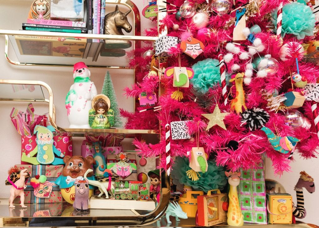 Hot pink Christmas tree styled with vintage toys.