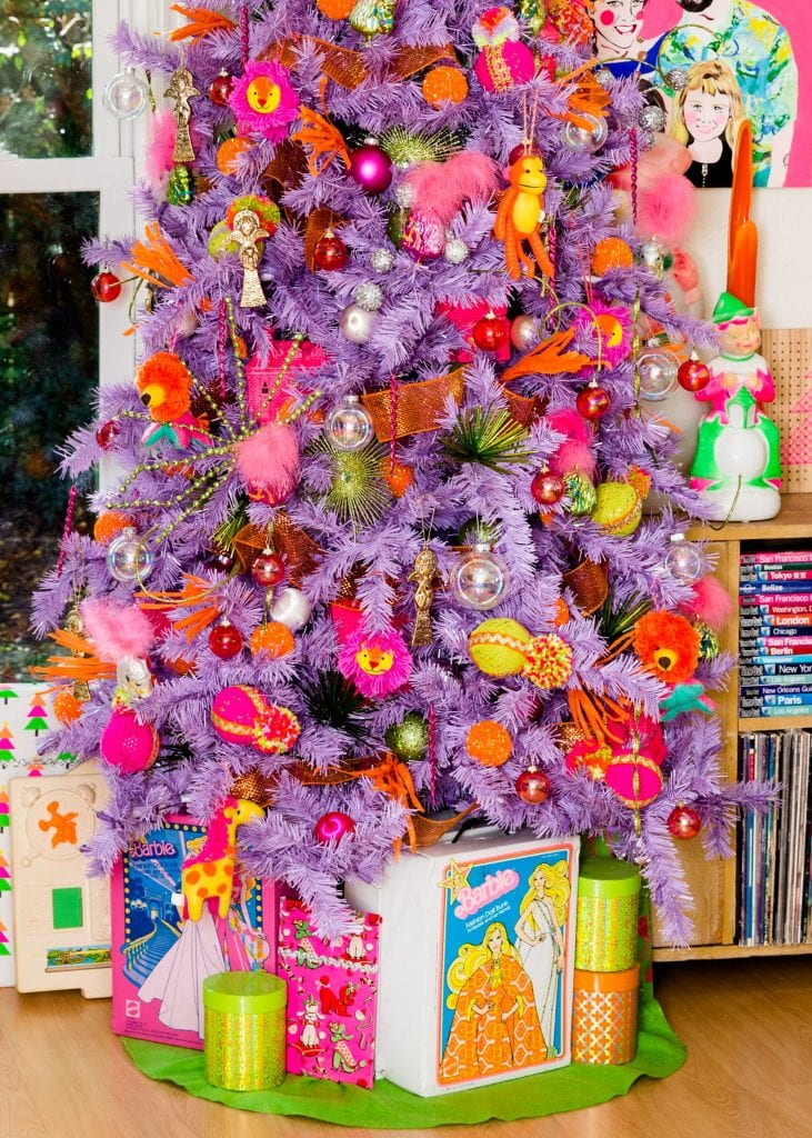 Lavender Christmas tree surrounded by vintage Mod toys.