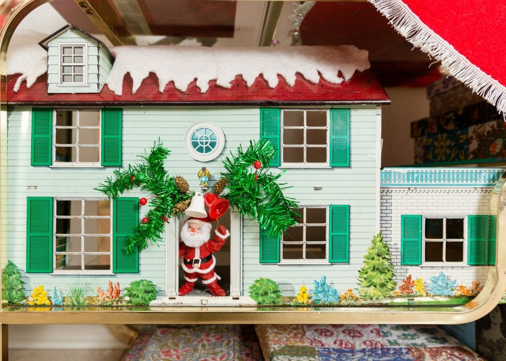 Vintage metal doll house decorated for Christmas