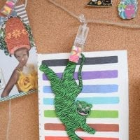 Eclectic art hanging from polymer clay clip lights.