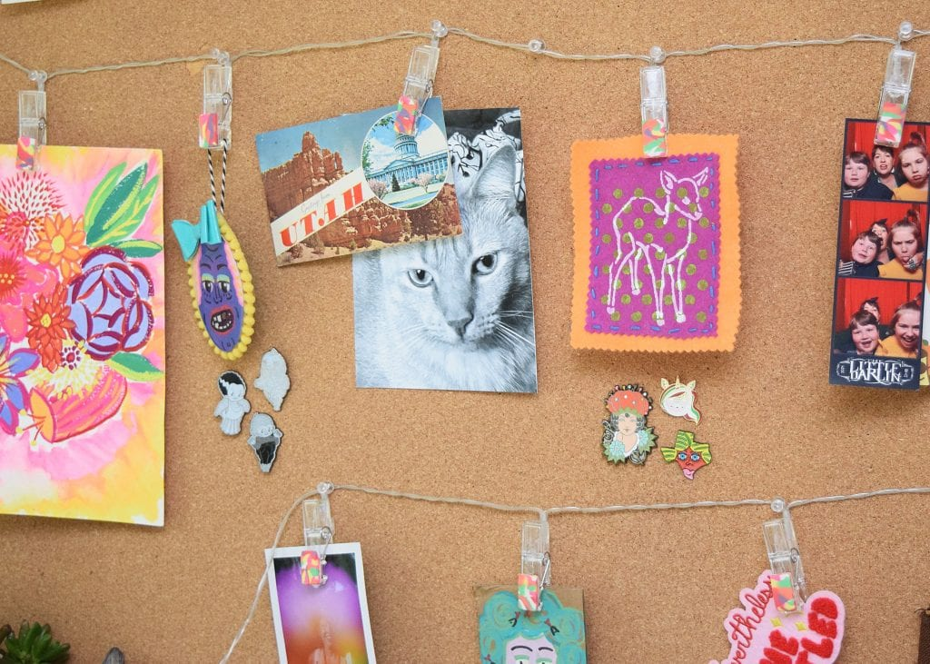 DIY tie-dye polymer clay embellished string lights on a bulletin board.
