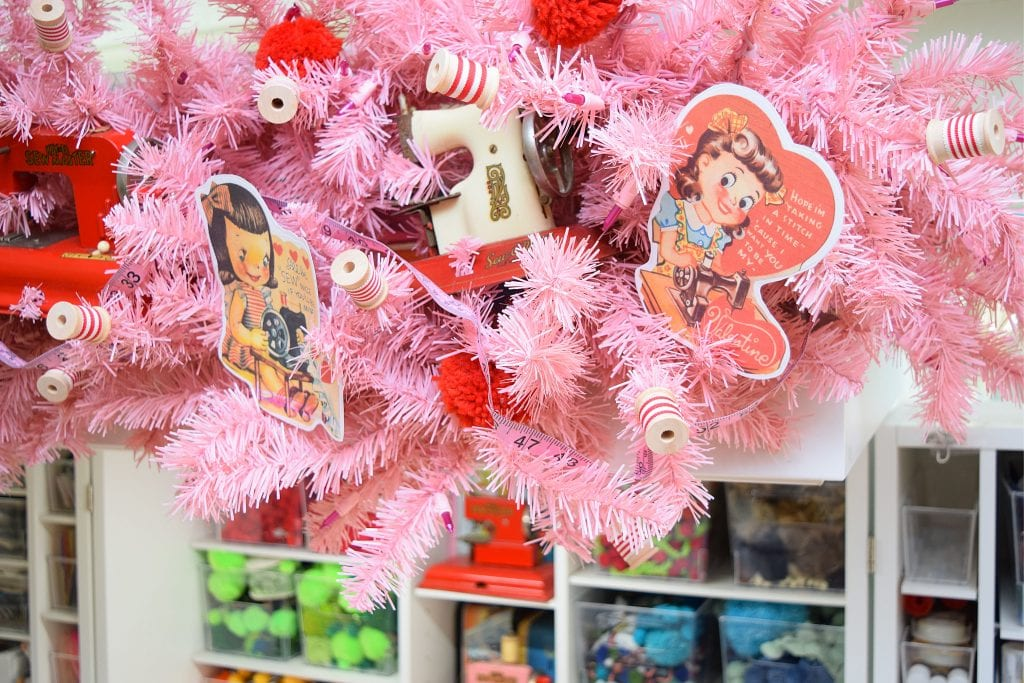 Pink garland decorated with vintage sewing Valentines.