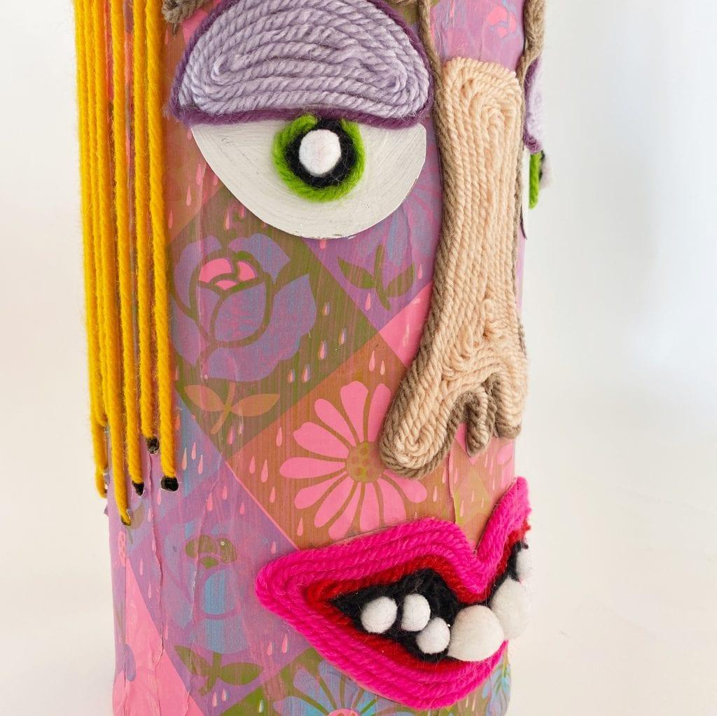 Mixed media jar painted with yarn.